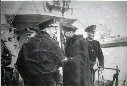 [photograph: General Eisenhower 'Ike' on D-Day plus one, going to Normandy on H.M.S. Apollo, a fast minelayer, Abdiel class. With Major General Ralph Royce, General Omar Bradley, unkonwn, RN Admiral BertramRamsay, and RN Petty Officer Ames on right. Courtesy: Gary Ames.